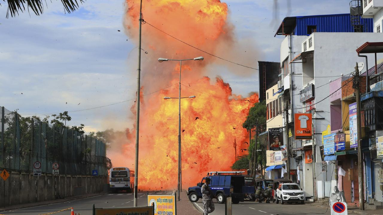 A suspicious object explodes in Colombo on April 22, a day after hotels and churches were hit in series of bomb blasts in Sri Lanka. Picture: The Yomiuri Shimbun via AP Images