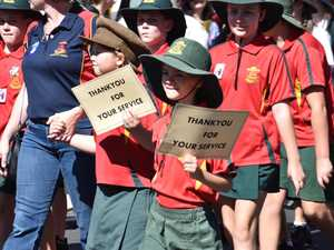 St Joseph's primary students wave signs thanking ex