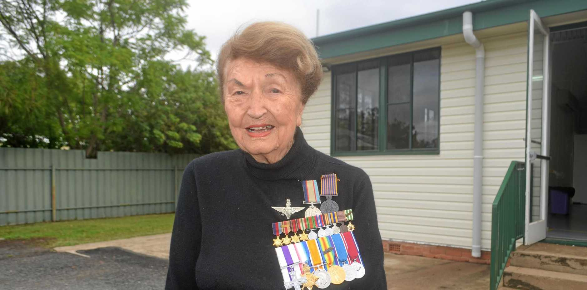 PROUD: Zena Warrian wearing her late husbands' and father-in-law's medals at the Injune Anzac service.