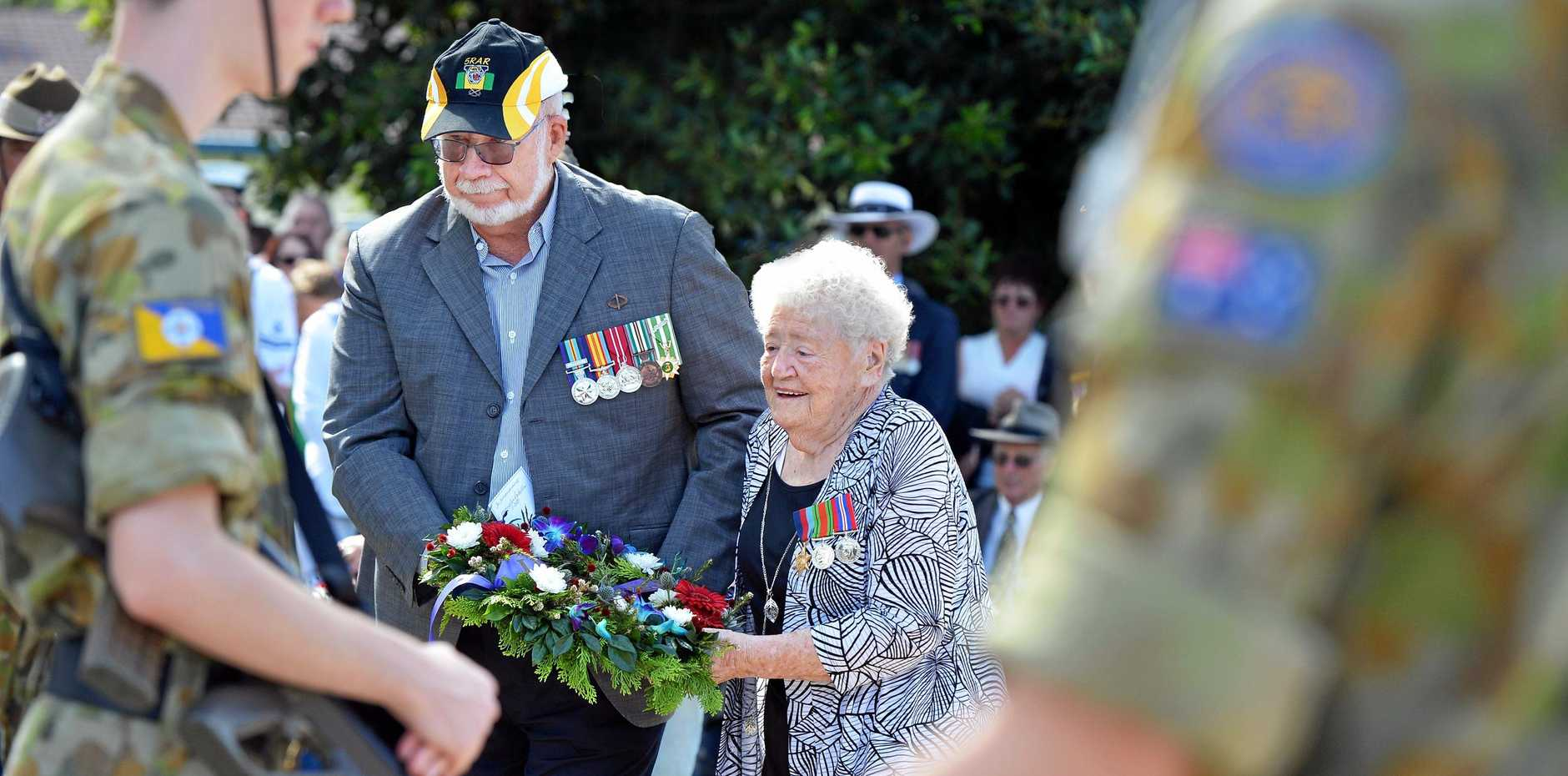 CLOSING A CHAPTER: Caloundra RSL Sub-branch member Gary Phillips and veteran Elizabeth Philip laying a wreath.