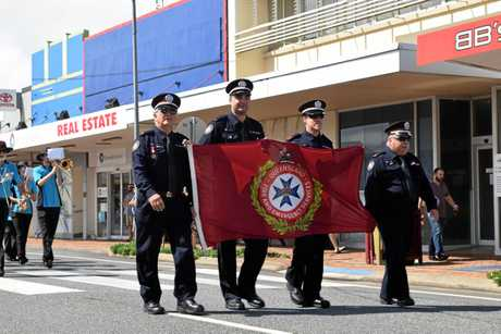 Queensland Fire and Emergency Services members in the Proserpine Anzac Day march.