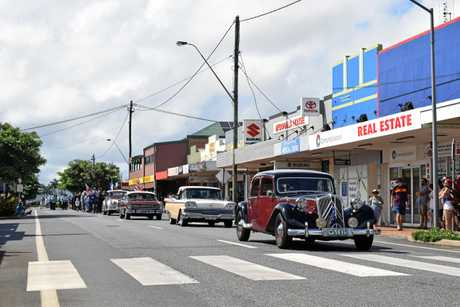 Vintage cars at the pointy end of the Anzac Day march in Proserpine yesterday.