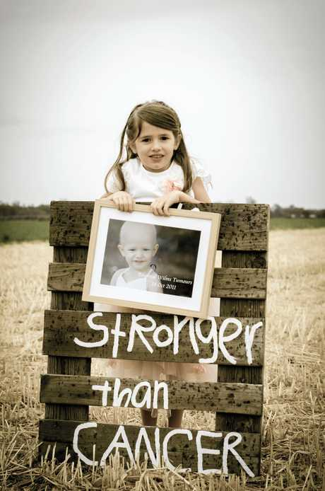 STRONGER: Madelyne Grange celebrates the end of her cancer treatment. She was diagnosed as a toddler with multiple tumours.