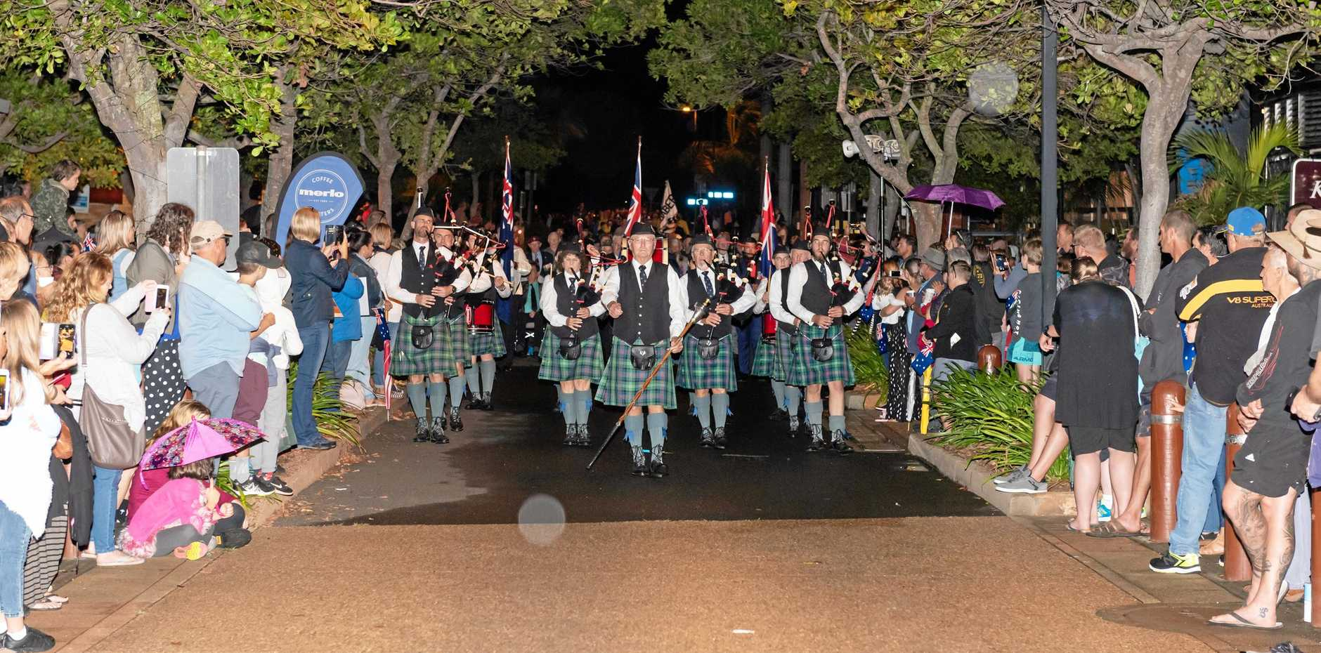 The parade marches into position for the Bargara dawn service.