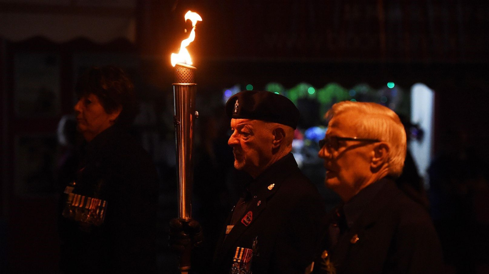 LEST WE FORGET: Toby Tidyman carries the flame at the Hervey Bay 2019 Anzac Day dawn service.