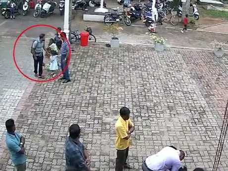 One of the suicide bombers pats a child on the head before bombing St Sebastian's Church in Negombo.