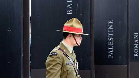 A member of the New Zealand Defence Force is seen in front of the Christchurch RSA building following the ANZAC Day Dawn Service. Picture: Getty