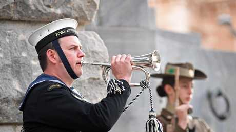 The last post during Anzac Day Dawn Service at the South Australian National War Memorial on North Terrace, Adelaide. Picture: Tom Huntley
