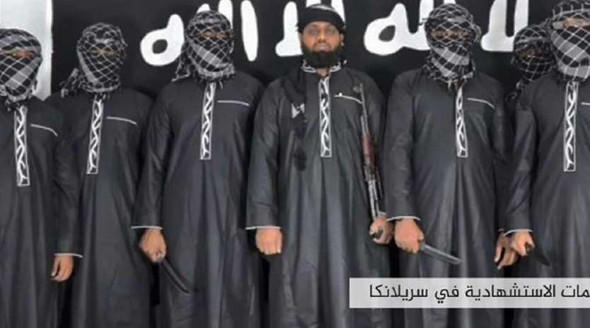 An image grab issued by IS's propaganda agency Amaq, allegedly shows eight men it said carried out the deadly suicide bomb blasts on Easter Sunday in Sri Lanka. Picture: Amaq/AFP