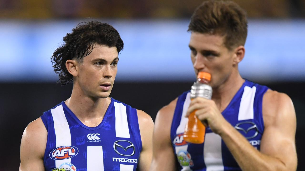 Jasper Pittard and Shaun Atley show their disappointment after North Melbourne's Good Friday hiding. Picture: AAP Image/Julian Smith.