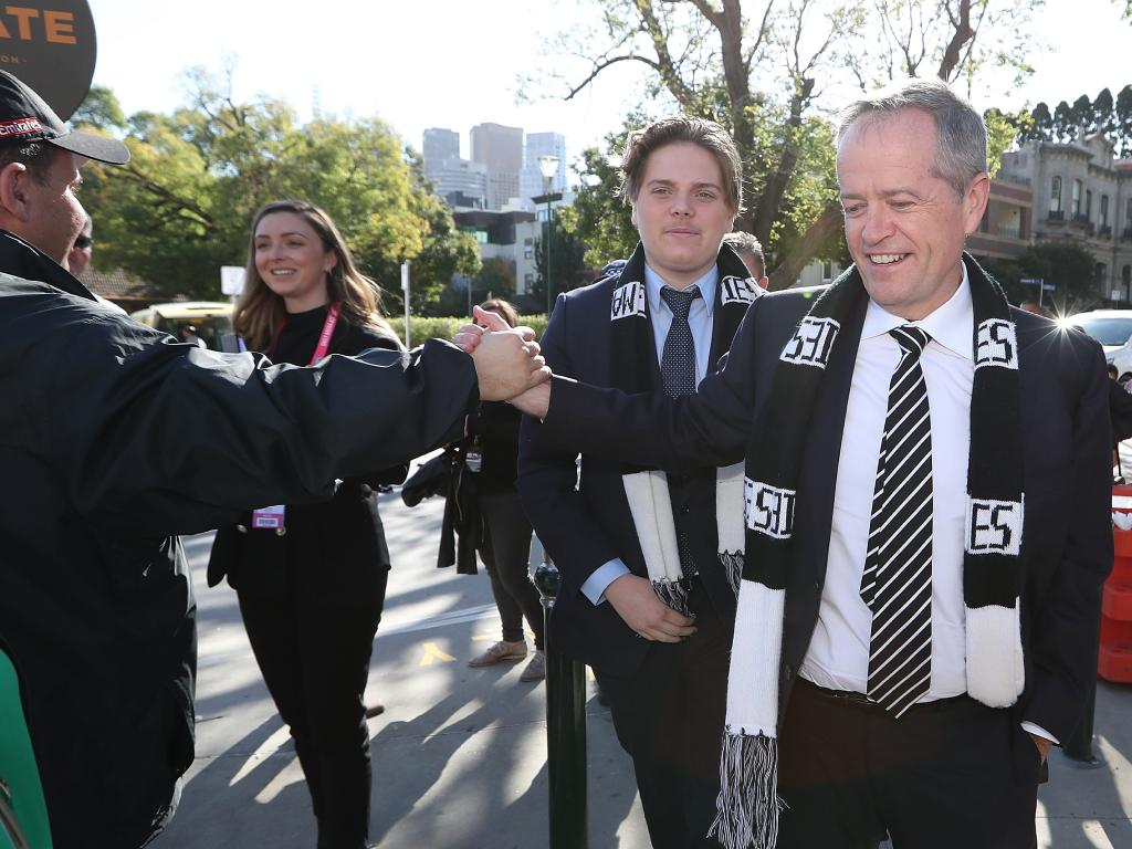 The Opposition Leader's allegiances were in full show as he boldly wore black and white. Picture: Kym Smith