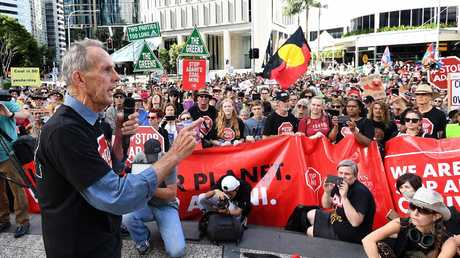 Bob Brown addresses protesters outside the Adani Headquarters in Brisbane on Monday. Picture: AAP/Dave Hunt