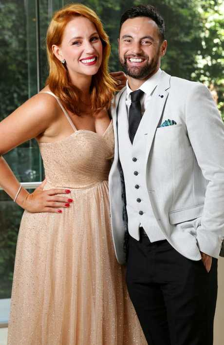 Jules Robinson, pictured with her fiance Cameron Merchant, is sick of people being nasty. Picture: Jonathan Ng