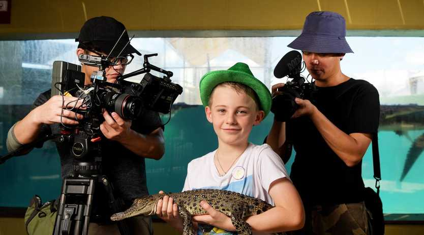 Public Television Service crew members Kuan Yu Chen and Wu Nan Chen are seen filming Darwin local Angus Copeland at Crocasaurus Cove. PICTURE: KERI MEGELUS