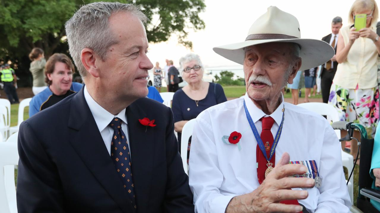 Bill Shorten talking with Austin Asche, 93, who served as a radar operator in World War II, after attending the dawn service in Darwin on Anzac Day. Picture: Kym Smith