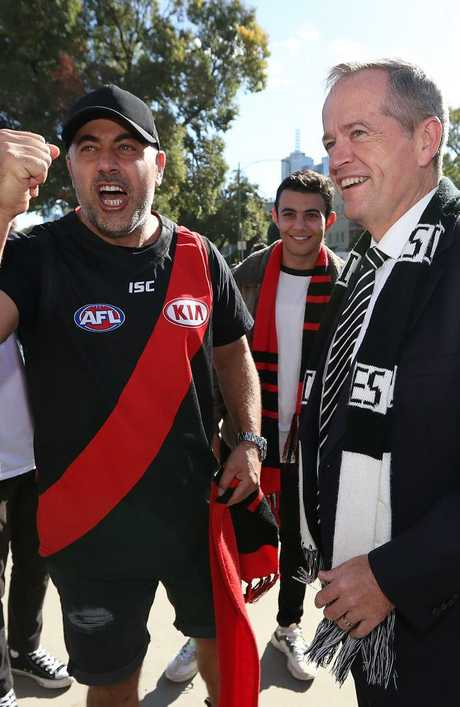 Bill Shorten copped friendly banter from Essendon supporters. Picture: Kym Smith