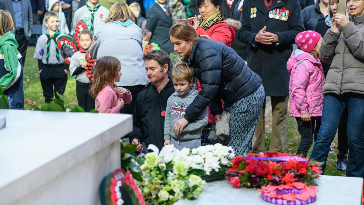 Members of the public react in front of the cenotaph during the ANZAC Day Dawn Service at Cranmer Square in Christchurch. Picture: Getty