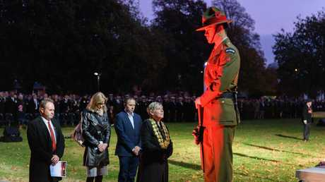 Christchurch Minister Lianne Dalziel (C) lays a wreath during the ANZAC Day Dawn Service at Cranmer Square. Picture: Getty