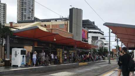Commuters faced delays after a woman was injured at a tram stop in Nerang St, Southport on Anzac Day.