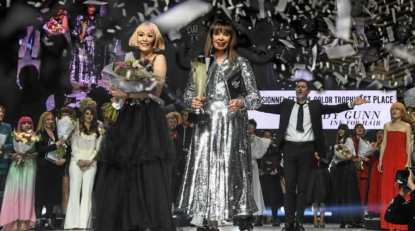 Wendy Gunn, accompanied by her hair model, receiving the prestigious 2019 L'Oreal Professional Style & Colour Trophy.