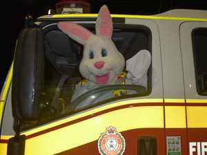 Easter Bunny grabs lift on fire truck