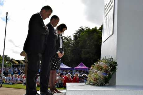 Nicklin MP Marty Hunt, Fairfax MP Ted O'Brien and Sunshine Coast councillor Jenny McKay lie wreaths during the Nambour Anzac Day morning ceremony at Quota Park.