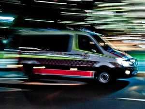 Man hospitalised after early morning car, bike crash