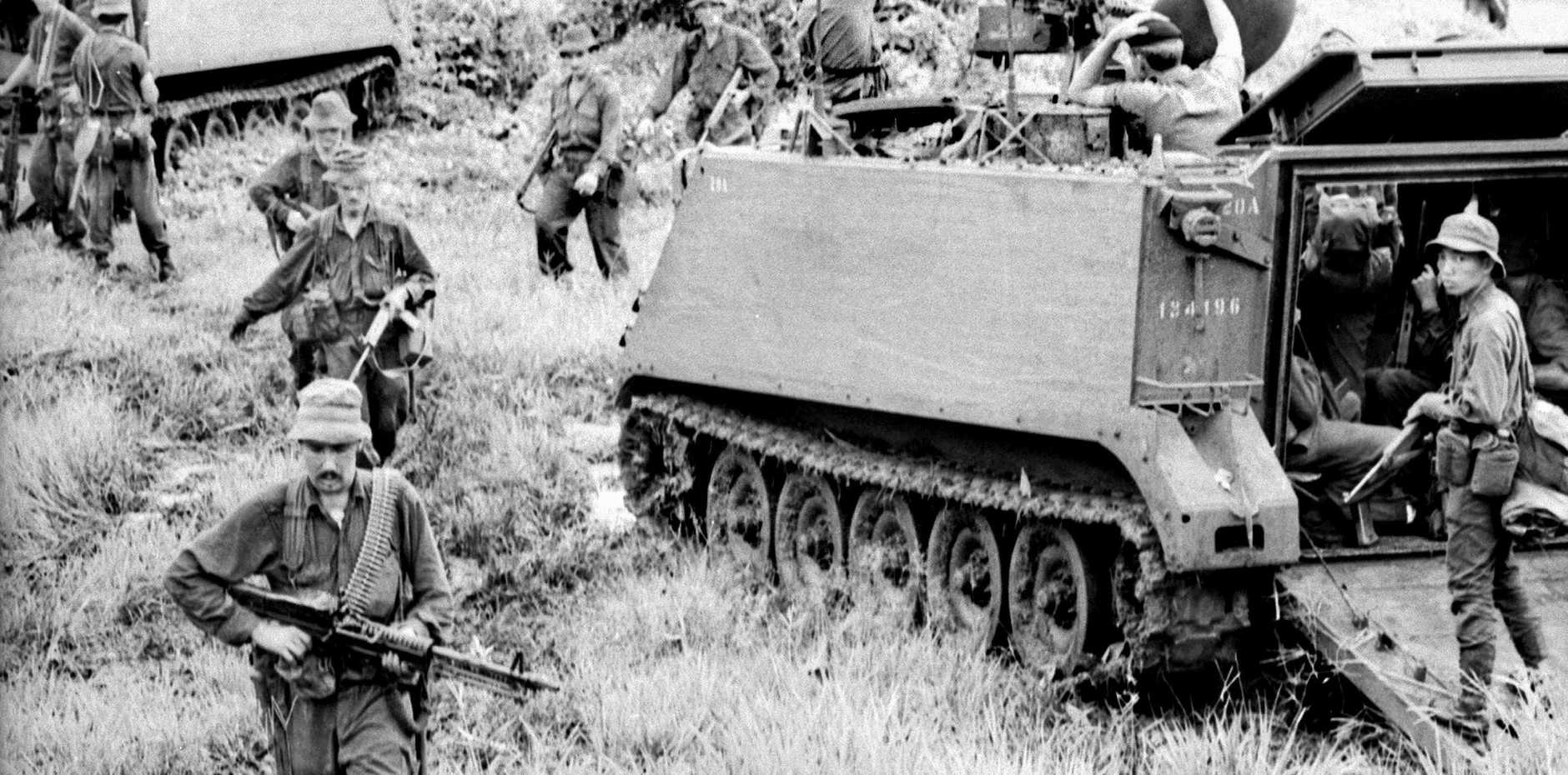 THE DAY AFTER: On August 19, 1966, troops of 1APC Squadron and Infantry sweep the area the day after the battle of Long Tan in then Phuoc Tuy province of South Vietnam, now Ba Ria-Vung Tau province of Vietnam.
