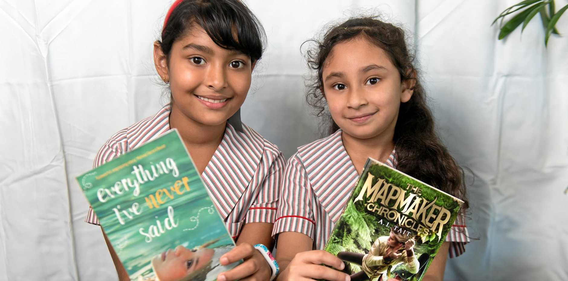 BOOK FESTIVAL: Tiana Sebastian, 8, and Umaiza Rashid, 7, with their favourite books by the authors in the Whitsunday Voices Youth Literature Festival.