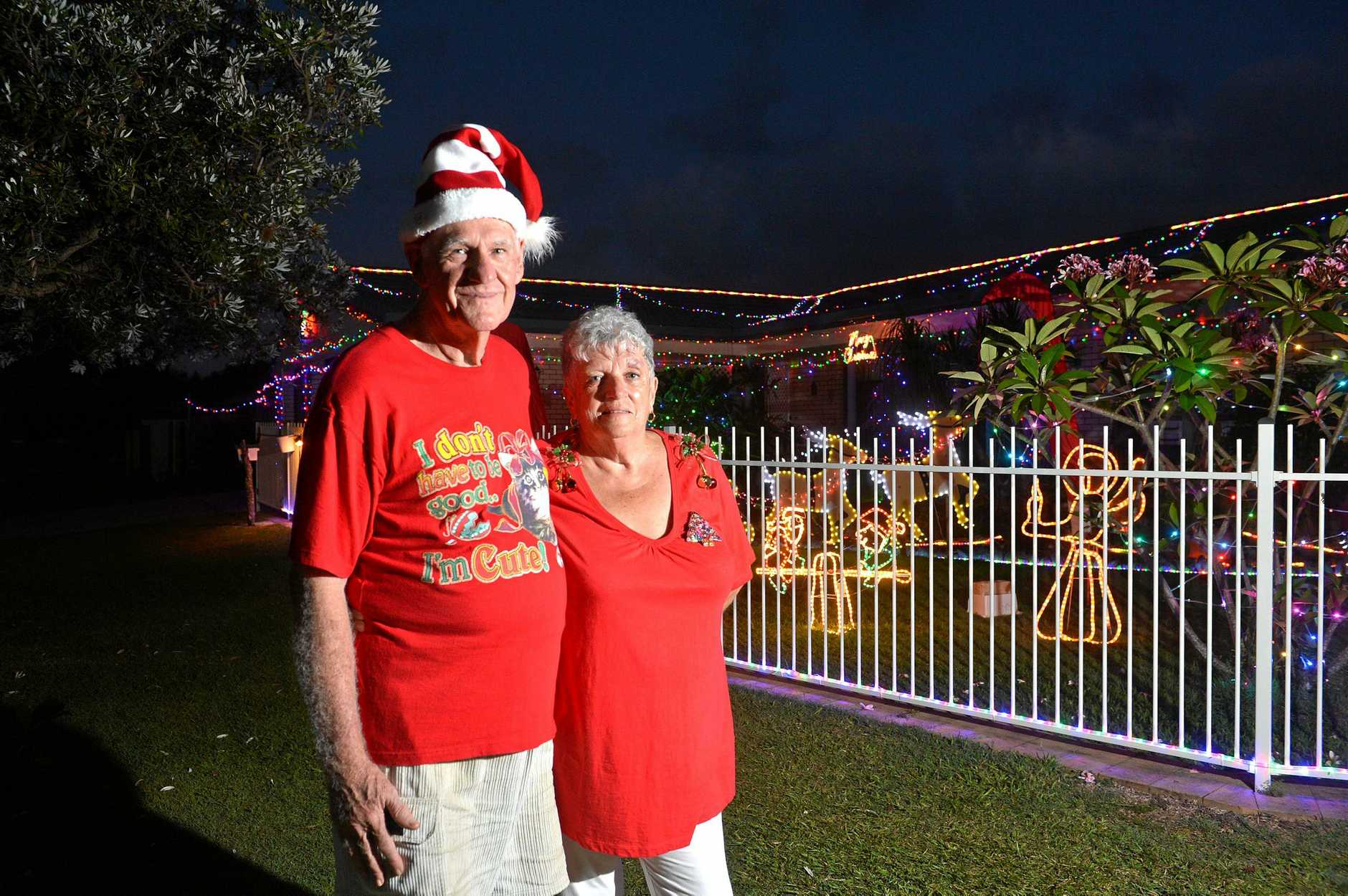 ALWAYS THINKING OF OTHERS: Bruce and Het Warrell with one of their charity fund-raising Christmas lights displays.
