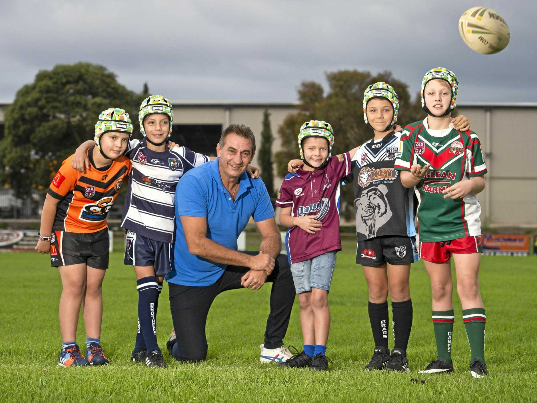 Almost 200 junior rugby league players, including (from left) Harrison Parsons (Souths), Lincoln Karaka (Brothers), Noah Marshall (Dalby), Wyatt Drury (Oakey) and Thomas Carney (Pittsworth), will today be given free protective headgear thanks to a The Great White Campaign spearheaded by campaign president Brendon Smith (centre).