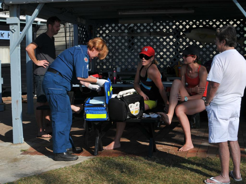 Tessa Kemp is treated after being attacked by Dingoes on Fraser Island. Pic: Luke McGoven