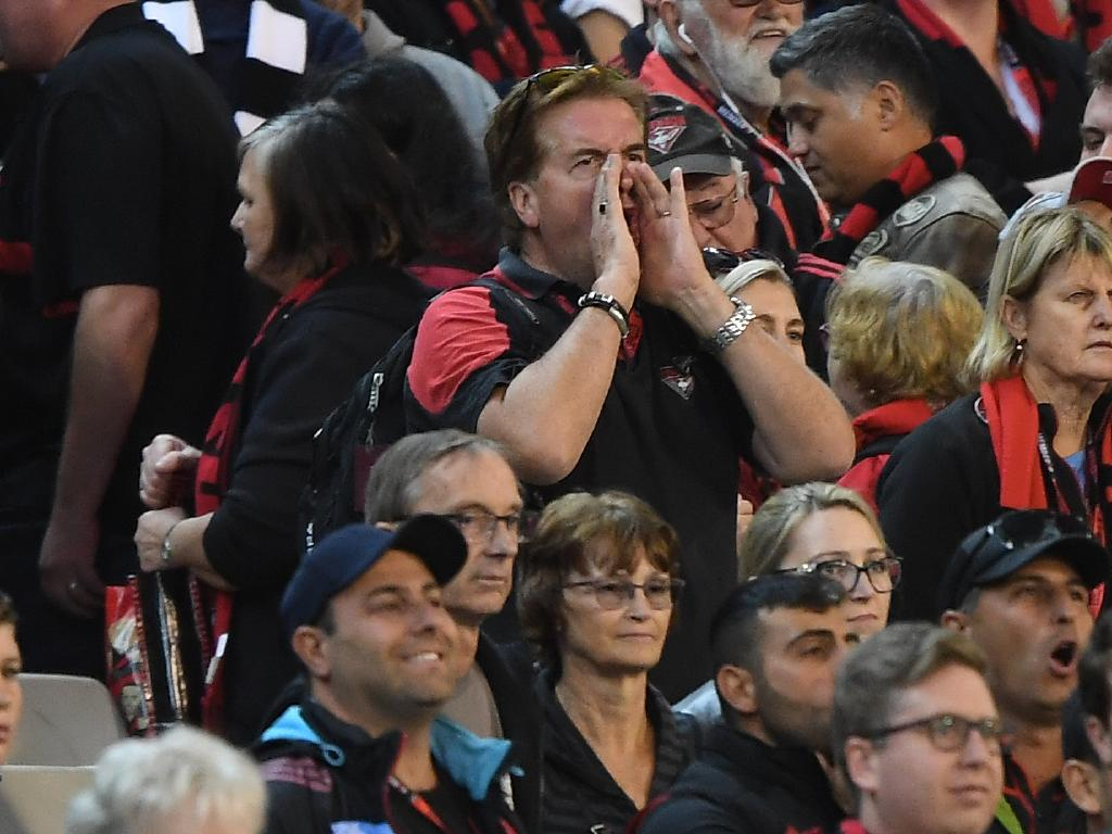 An Essendon fan lets rip. (AAP Image/Julian Smith)