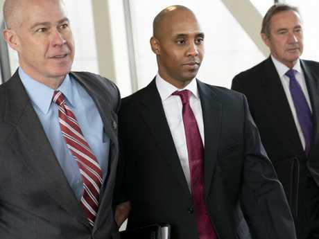 Former Minneapolis police officer Mohamed Noor, centre, leaves the Hennepin County Government Center after the first day of jury selection with his lawyers Thomas Plunkett, left, and Peter Wold, in Minneapolis. Picture: AP