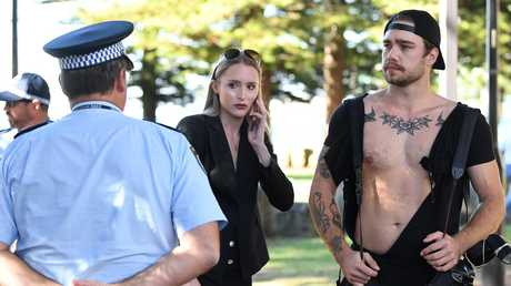 Photographer Dylan Robinson (right) and reporter Eliza Barr (centre) are seen after a confrontation at the press conference. Picture: Joel Carrett