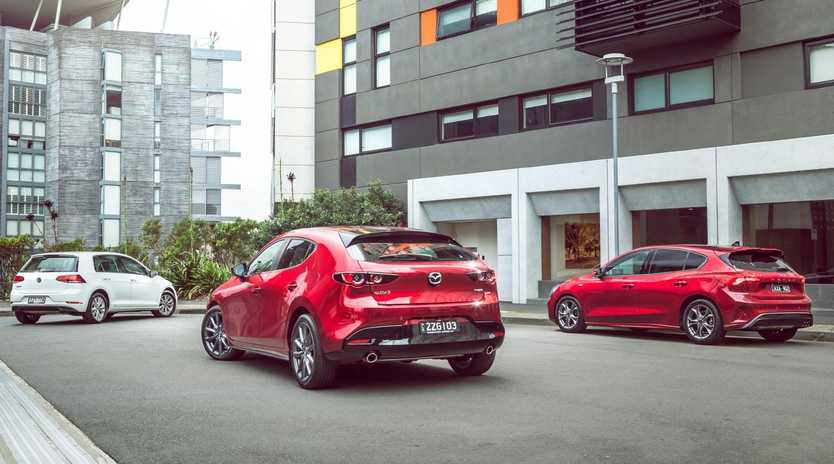 The Volkswagen Golf (left), Mazda3 (middle) and Ford Focus are three of the most accomplished small cars on the market. Photo: Thomas Wielecki.