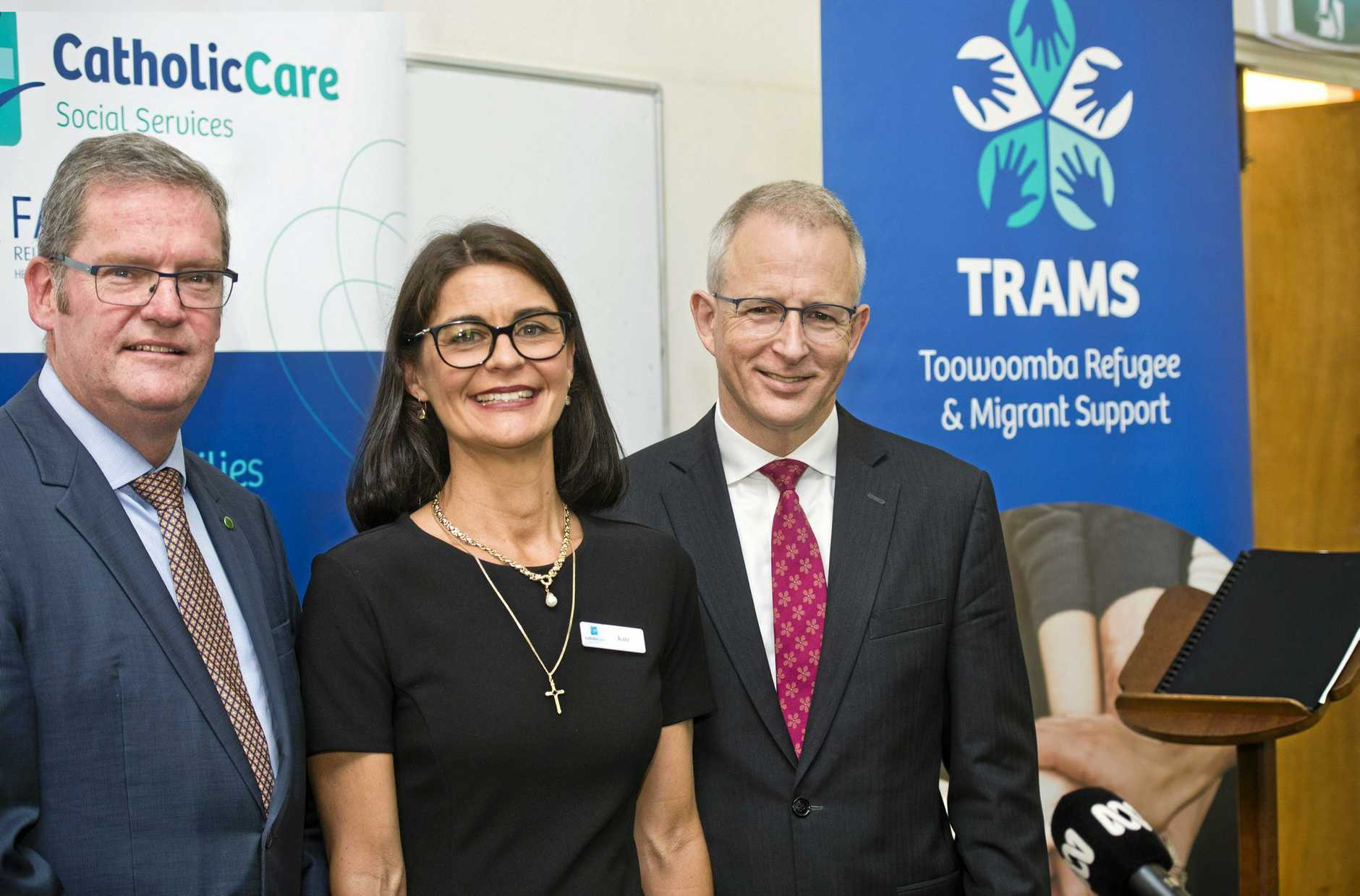 BIG BOOST: Announcing a $400,000 increase to refugee service TRAMS are (from left) Groom MP John McVeigh, CatholicCare director Kate Venables and Families and Social Services Minister Paul Fletcher.