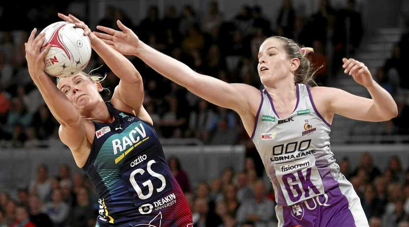 The Vixens' Caitlin Thwaites gets the better of the Firebirds' Tara Hinchliffe at Melbourne Arena on Saturday. Picture: Daniel Pockett/AAP