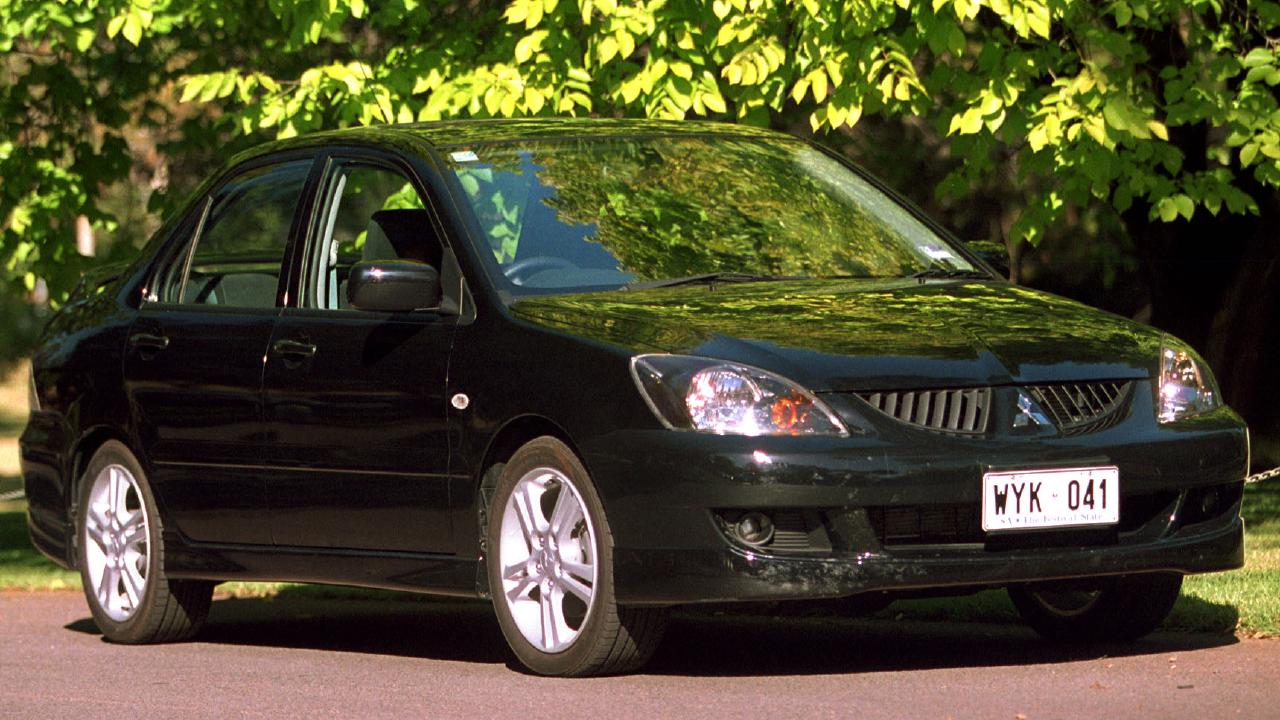 Lewis' first car was a humble Mitsubishi Lancer.