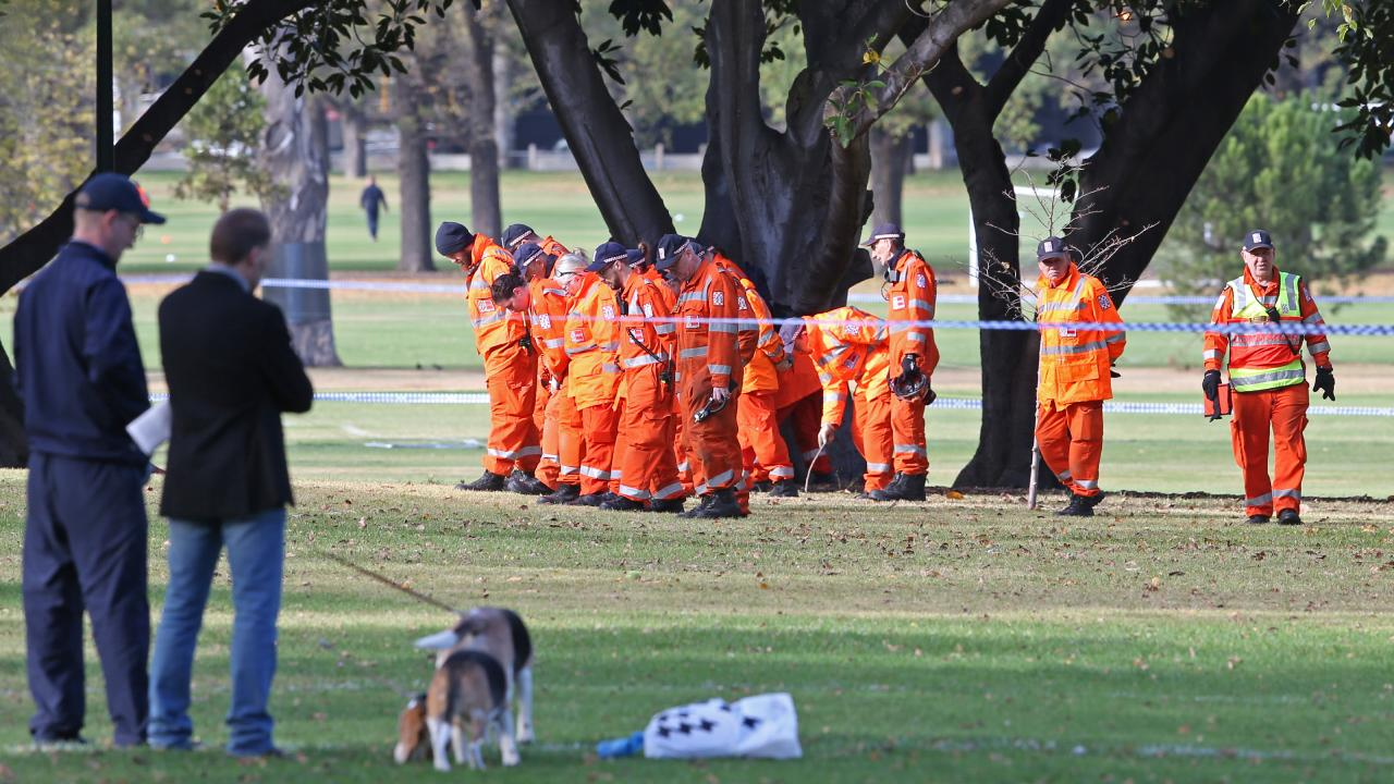 Police at the scene of a homicide in South Yarra in Fawkner Park. Picture: David Crosling
