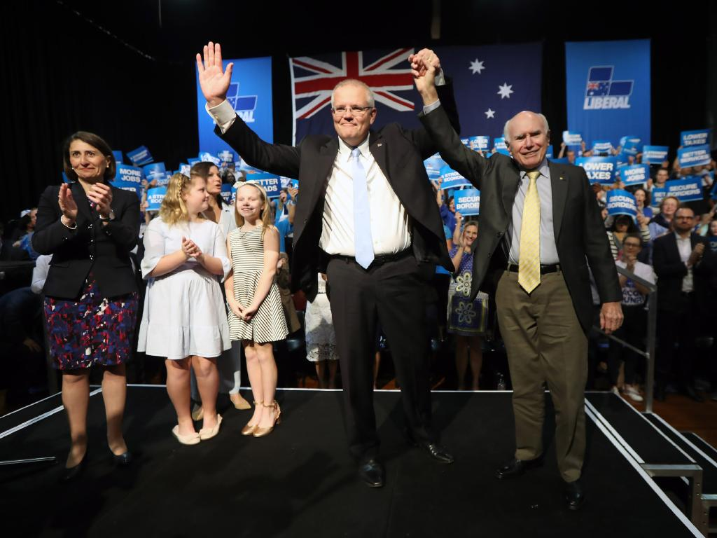 The PM with  NSW Premier Gladys Berejiklian and former PM John Howard. Picture Gary Ramage