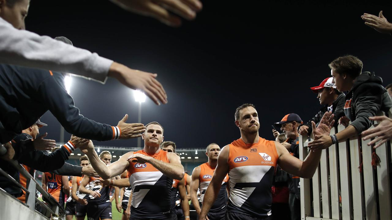 Heath Shaw and Shane Mumford celebrate after GWS's win. Picture: Getty Images