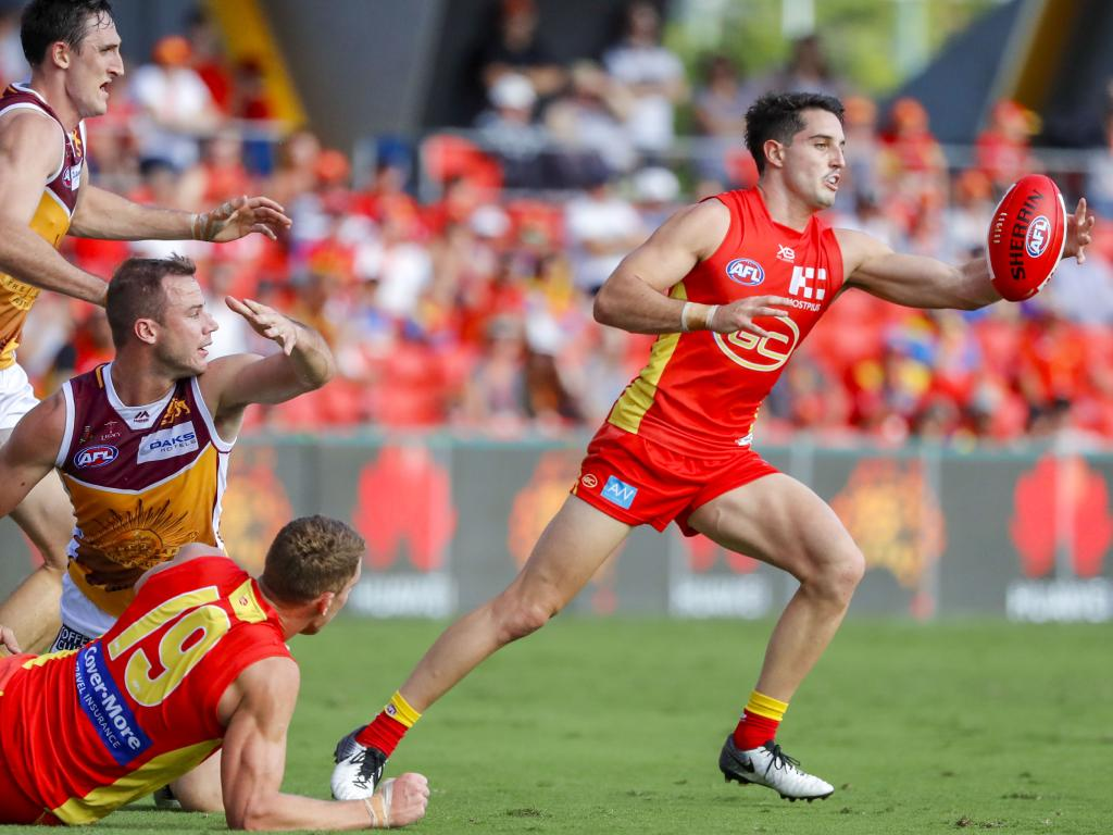 Brayden Fiorini of the Suns with the ball during the Round 6 AFL match between the Gold Coast Suns and the Brisbane Lions at Metricon Stadium on the Gold Coast, Saturday, April 27, 2019. (AAP Image/Glenn Hunt).