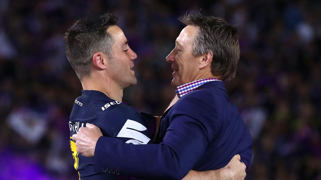 Cooper Cronk with coach Craig Bellamy after winning the 2017 NRL Grand Final. Bellamy decided he wanted to be a one-club player. Picture: Mark Kolbe/Getty Images