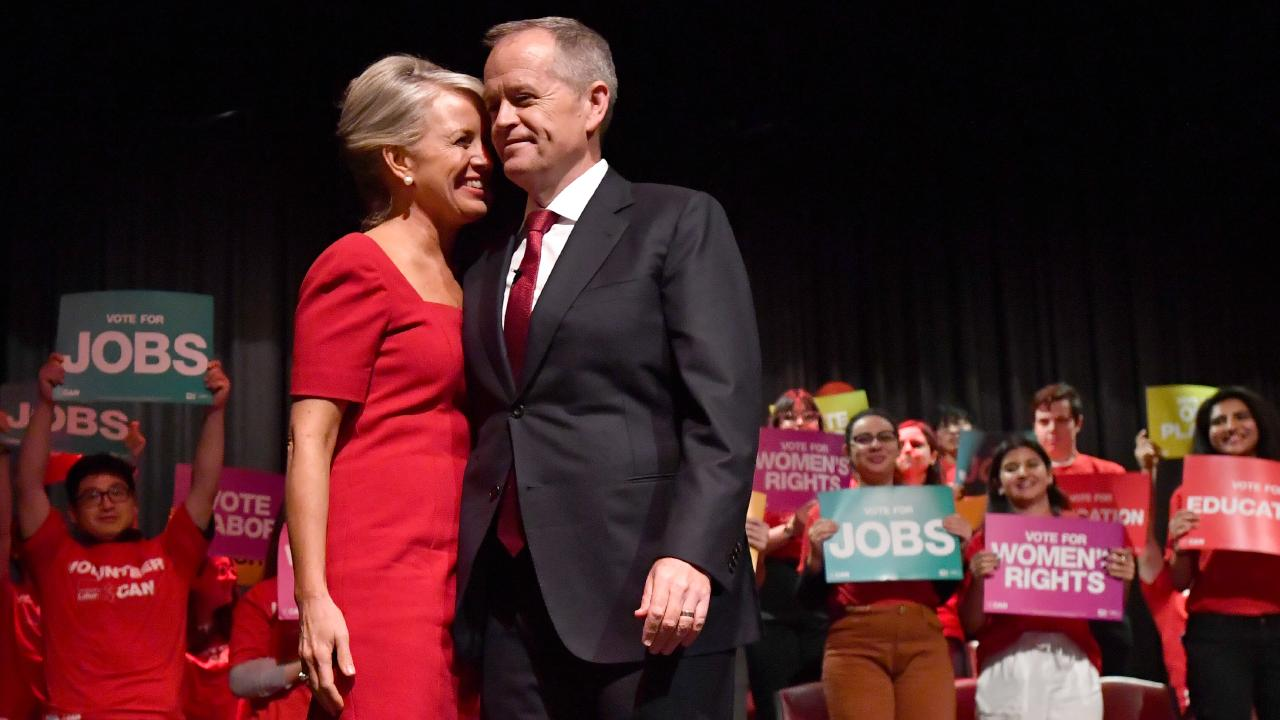 Mr Shorten with his wife Chloe during a Labor Party campaign rally at Box Hill Town Hall in Melbourne on Sunday. Picture: AAP/Darren England