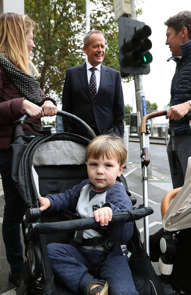 Bill Shorten talks to Deborah and Edward Sanders and their two-year-old son Thelonious in Melbourne. Picture Kym Smith