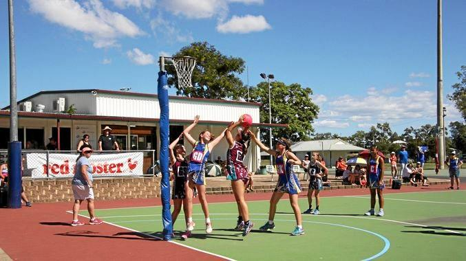 BROAD EXPERIENCE: Action between Gladstone and Rocky's under-13 teams at the Representative Netball Red Rooster Carnival.