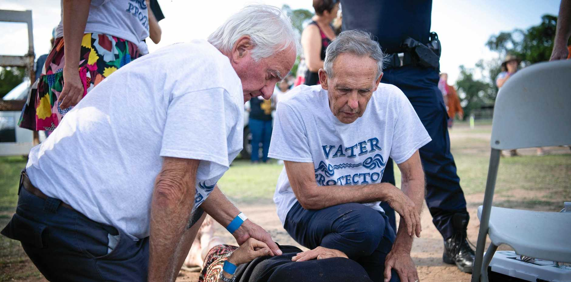 Supplied image obtained Sunday, April 28, 2019 of former Greens leader Bob Brown (right) with a northern NSW woman who was injured during a Stop Adani Convoy event in Clermont. A man on horseback has been arrested after he allegedly knocked over a woman while riding into an anti-Adani protest in central Queensland. (AAP Image/Matthew Newton/Bob Brown Foundation) NO ARCHIVING, EDITORIAL USE ONLY