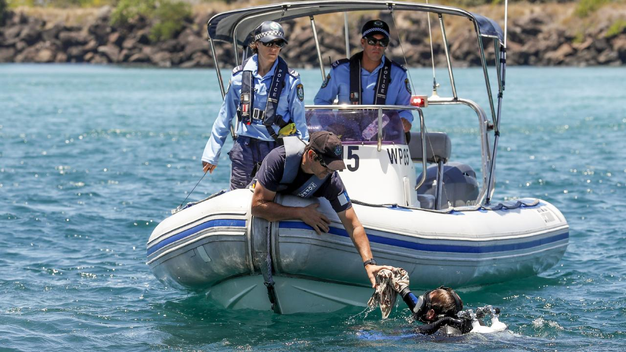 Police search for evidence at the Tweed River following the death of the baby girl. Picture: AAP