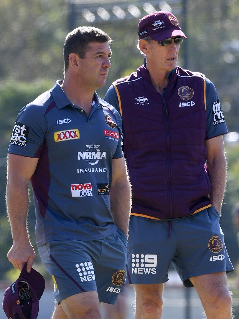 Jason Demetriou (left) with Wayne Bennett during a training session last season. Picture: AAP
